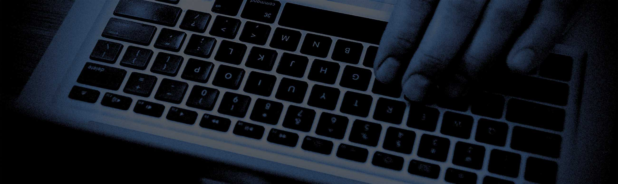 Frequently Asked Question Header Background of Hands Typing On A Laptop